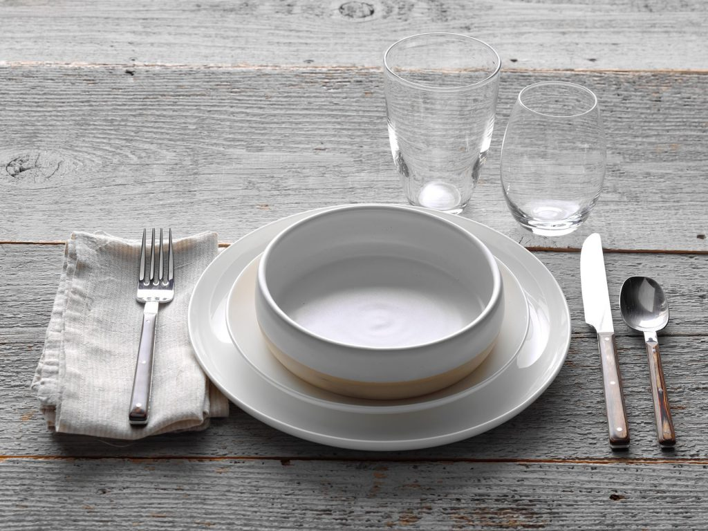 Elevate your at home dining experience with a casual dinner party place setting
